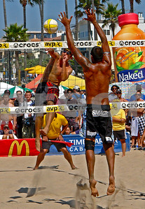 Two time USA Olympian Sean Rosenthal spikes past Fred Sousa at The Manhattan Beach Open.