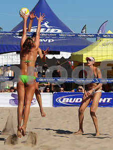 Three Time Olympic Champion Misty May Treanor dinks as Olympic teammate Kerry Walsh (at right) watches, Manhattan Beach Open.