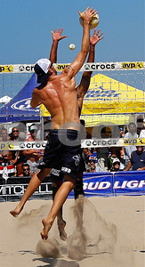 Two Time USA Olympian Jake Gibb spikes over Fred Sousa in Manhattan Beach Open