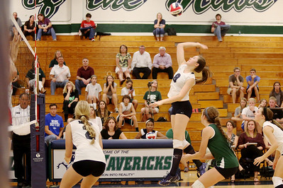 McNeil's Rebecca Latham goes up for a kill against Vista Ridge.