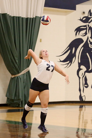 McNeil's Kelly McConnell serves against Vista Ridge.
