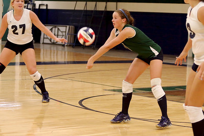 McNeil's Zoey Frazier digs the ball against Vista Ridge