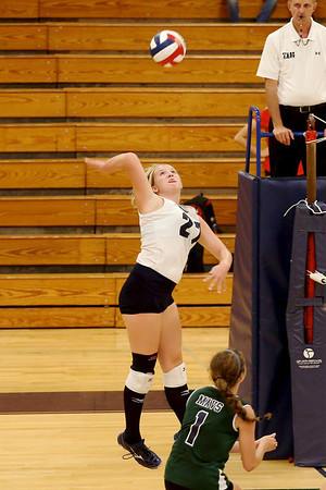 McNeil's Kelly McConnel goes up for a kill against Vista Ridge.