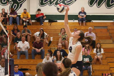 McNeil's Rebecca Latham goes for a kill against Vista Ridge.