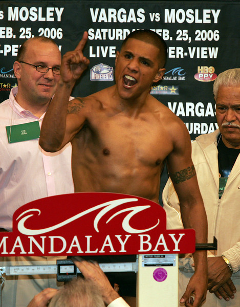 """Ferocious"" Fernando Vargas and ""Sugar"" Shane Mosley clashed in a highly anticipated junior middleweight ""Showdown"" at the Mandalay Bay Resort in Las Vegas, Nevada on February 25, 2006.  Mosley went on to take the victory with a 10th round TKO.  The fight was stopped by the referee when a first round injury to Vargas's left eye worsened and caused his eye to become swollen shut.  Vargas weighed in at 153.5 pounds at the February 24th ceremony."