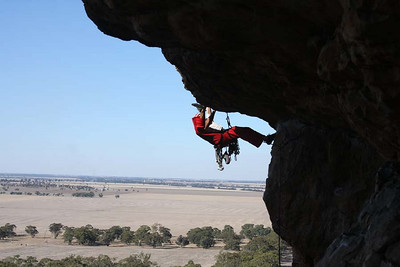 Hand hold and a heel hook! Trent on Pilot Error. Mt. Arapiles, Victoria, Australia. Photography by Marikki Patrikka.