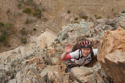Marikki a little bit happier already, 60m to the ground. Mt. Arapiles, Victoria, Australia. Photography by Trent Williams.