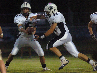 Prairie Central's Addison Bounds (15) hands off the ball to Trent Bounds (21) during a Corn Belt Conference high school football game against Central Catholic on Friday (Sept. 10, 2010) at Bill Hundman Memorial Field in Bloomington. (Pantagraph/Joel Fellers)