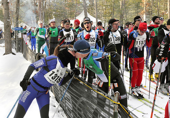 "Record-Eagle/Keith King <br /> Karen Dawson, of Farmington Hills, shares a kiss with her husband, Ken, prior to the start of his race while a fellow skier jokingly says, ""Hey, no fair!,"" Saturday, February 12, 2011 during the North American Vasa at Timber Ridge Resort."