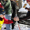 Record-Eagle/Keith King <br /> Jakob Olechiw, 9, of New Hudson, is congratulated by his father Mike, after crossing the finish line Saturday, February 12, 2011 during the North American Vasa at Timber Ridge Resort.