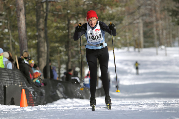 Record-Eagle/Keith King <br /> Marnie Sutter, of Cedar, finishes first in the 27 km classic womens division Saturday, February 12, 2011 during the North American Vasa at Timber Ridge Resort.