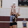 Record-Eagle/Keith King<br /> Traverse City Christian's Shannon Ufer, right, jumps to hit the  ball as Grand Traverse Academy's Hannah Sivek, left, defends Monday, September 10, 2012 at Traverse City Christian School.