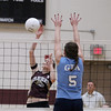 Record-Eagle/Keith King<br /> Traverse City Christian's Mikayla Brett hits the ball against Grand Traverse Academy Monday, September 10, 2012 at Traverse City Christian School.