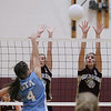 Record-Eagle/Keith King<br /> Traverse City Christian's Shannon Ufer, left, and Laura Murray, right, jump to block a shot by Grand Traverse Academy's Lindsey White Monday, September 10, 2012 at Traverse City Christian School.