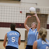 Record-Eagle/Keith King<br /> Grand Traverse Academy's Amelia Peck sets the ball as Traverse City Christian's Laura Murray, left, and Madeline White ready themselves  Monday, September 10, 2012 at Traverse City Christian School.