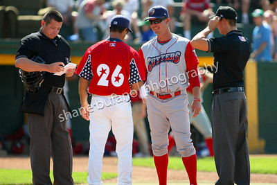 Williamsport Crosscutters Manager Chris Truby meets with Vermont Lake Monsters Manager Jeff Garber as they discuss the ground rules with the umpires at Centennial Field, July 4, 2010, Burlington, VT