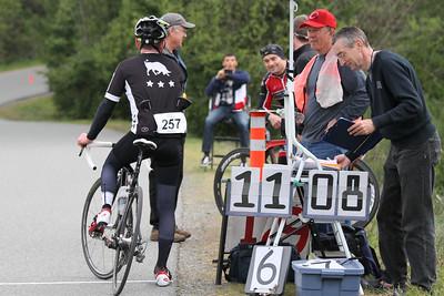 Luke Young done: John Errington (grey cap; finish line), Ian Phillips (red cap; race organizer), Bruce Falk (finish line, lap counter)