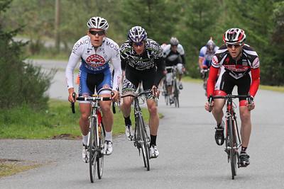 A breakaway established (2nd lap?); Tyler, Jeff, Curtis passing Cs
