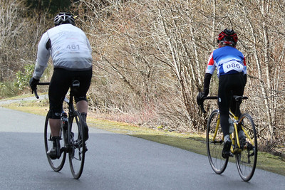 Dave Spiers (B) encourages Isaac van der Vliet (11yr; C) up the steepest part of course