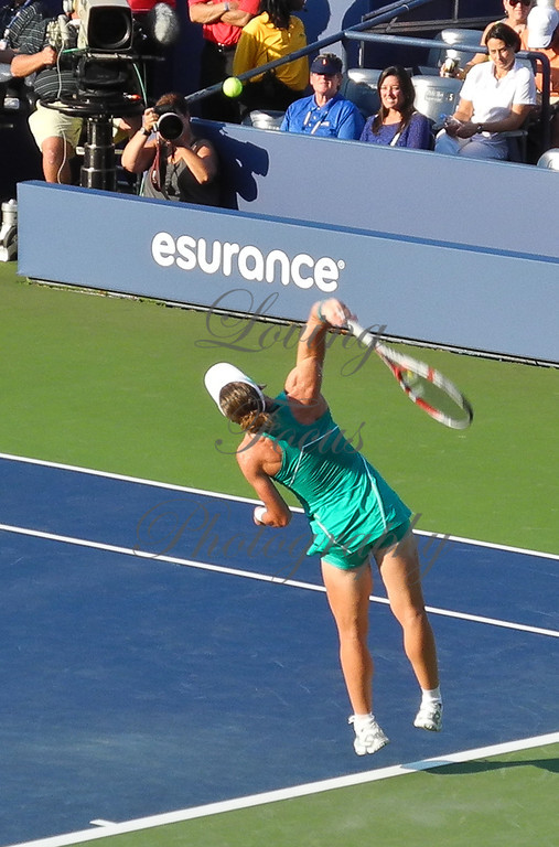 ... that launch a follow through of her upper body. A pronated wrist, directs the ball.