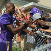 Minnesota Vikings running back Adrian Peterson signs autographs after the team's last practice at Minnesota State University Thursday. Photo by Pat Christman