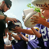 Vikings linebacker Michael Mauti works his way down the autograph line after arriving in Mankato on Thursday for the beginning of training camp at Minnesota State University, Mankato. Photo  by John Cross