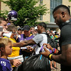 Viking players Brandon Watts (front) and Jerick McKinnon work their way down a line of autograph seekers after arriving in Mankato on Thursday for the team's preseason training camp at Minnesota State University, Mankato. Photo by John Cross