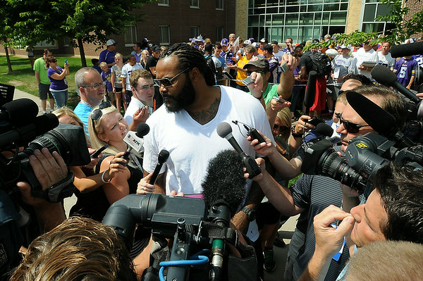 Viking tackle Phil Loadholt is surrounded by media after arriving in Mankato on Thursday for the team's preseason training camp at Minnesota State University, Mankato. Photo by John Cross