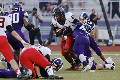 Jayvion Cameron carries the ball against Elgin at Wildcat Stadium in Elgin.