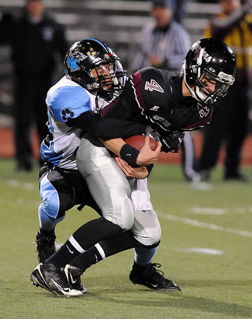 """Silver Creek quarterback, Austin Apodaca, is sacked by Javan Bridges of Vista Ridge.<br /> For more photos of the game, go to  <a href=""""http://www.dailycamera.com"""">http://www.dailycamera.com</a>.<br /> Cliff Grassmick / November 19, 2010"""
