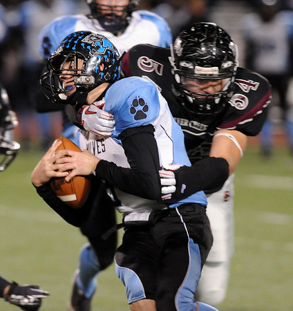 "Igor Pelowski of Silver Creek, pulls down Thomas Newman, the Vista Ridge quarterback.<br /> For more photos of the game, go to  <a href=""http://www.dailycamera.com"">http://www.dailycamera.com</a>.<br /> Cliff Grassmick / November 19, 2010"