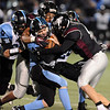 "Trace Gray, top left, and Cameron Cadora, both of Silver Creek, tackle QB Thomas Newman of Vista Ridge.<br /> For more photos of the game, go to  <a href=""http://www.dailycamera.com"">http://www.dailycamera.com</a>.<br /> Cliff Grassmick / November 19, 2010"