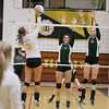 Record-Eagle/Keith King<br /> Traverse City West's Katie Placek (11), right, and Mattison Mokanyk (1), jump as Traverse City Central's Callie Bartkowiak (3) hits the ball Wednesday, October 24, 2012 at Traverse City Central High School.
