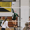 Record-Eagle/Keith King<br /> Traverse City West's Courtney VanHouzen jumps to hit the ball against Traverse City Central Wednesday, October 24, 2012 at Traverse City Central High School.