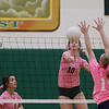 Record-Eagle/Keith King<br /> Traverse City West's Courtney VanHouzen hits the ball against Petoskey Monday, October 15, 2012 at Traverse City West High School. Both teams wore pink (Traverse City West shirts had dark numbers while Petoskey had white) for the Dig Pink event in honor of Breast Cancer Awareness Month.