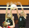 Gate City #5 Jennifer Lewis and #6 Kandra McDavid block a shot against Rye Cove High School during the Region D Volleyball Tournament. Photo by Erica Yoon