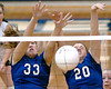 Tessa Burton, #33, and Brittany Simpson, #20, block ball into net during match against Wise. Photo by Ned Jilton II