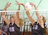 Gate City's Ashton Dougherty, 13, and Chelsea Spivey, 22, block shot during Dist playoff. Photo by Ned Jilton II