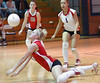 #2 for Twin Springs dives for shot during  victory in first game of match. Photo by Ned Jilton II