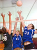 Gate City's #11, Lindsey Burke, and #33, Erica Fugate go up after ball with Battle's #28 Kelsey Griffitts. Photo by Ned Jilton II