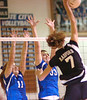 Gate City's Lindsey Burke, #11, and Erica Fugate, #33, go up for block against #7 of Radford during playoffs. Photo by Ned Jilton II