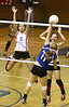 Powell Valley #10 and #6 try to block a spike by Gate City #11. Photo by Erica Yoon