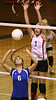 Gate City #6 sets the ball for her teammates as Powell Valley #1 tries to block. Photo by Erica Yoon
