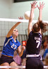 Gate City's #23, Santana Bishop, hits one off the top of the net during playoff action against Radford. Photo by Ned Jilton II