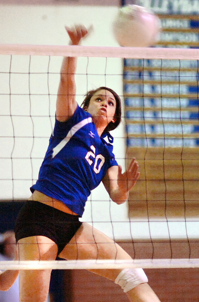 Gate City's Brittany Simpson, #20, smashes one over the net during palyoff action against Radford. Photo by Ned Jilton II
