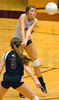 #2 Lori Peterson hits shot in front of teammate Katelyn Fleming, #5. Photo by ned Jilton II