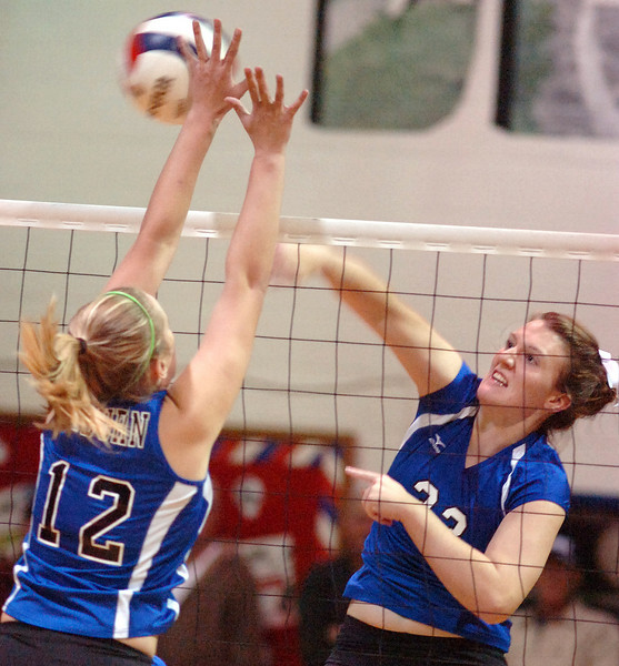 Gate City's #33, Erica Fugate, smashes one past the block of Auburn's #12, Katie Hudak. Photo by Ned Jilton II