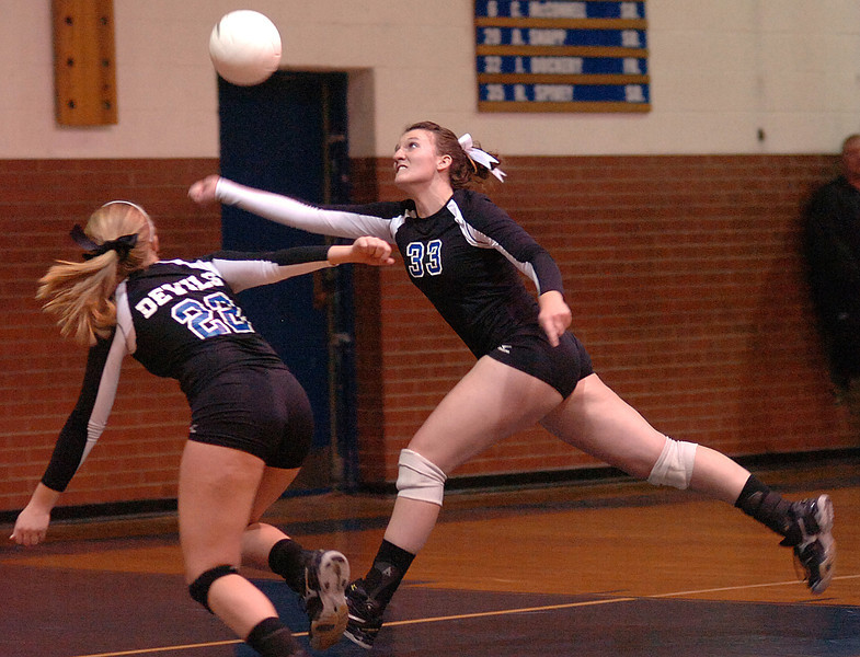 Gate City's #33, Erica Fugate, and #22, Haley Reed, both chase after ball with Fugate saving it from going out. Photo by Ned Jilton II
