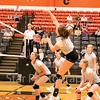 Star Photo/Larry N. Souders<br /> Elizabethton's Sydney Goodsell (32) drives a kill back over the net Monday night against Science Hill.