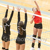 Star Photo/Larry N. Souders<br /> Elizabethton's Hannah Booster (25) delivers a kill shot over Unicoi's Emma Kelly (2) and Sarah Larkey (32) in a season opening tournament at Sullivan South Monday night.